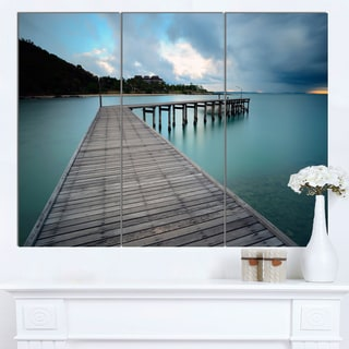 Designart 'Wooden Bridge to Calm Ocean' Modern Bridge Canvas Wall Art
