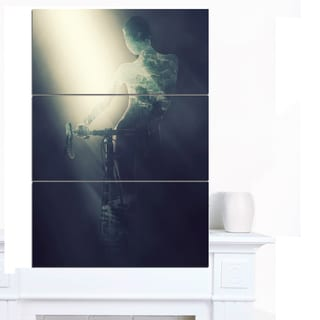 Designart 'Woman with Bicycle in Spotlight' Modern Portrait Canvas Wall Art
