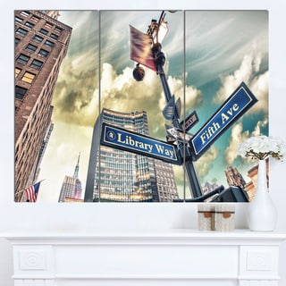 Designart 'Library Way and 5th Avenue Street Signs' Modern Cityscape Canvas Artwork
