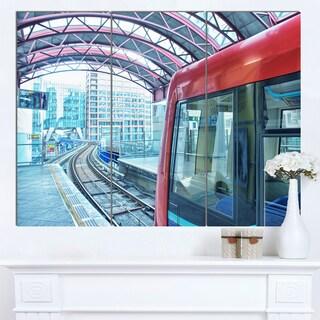 Designart 'Departing London Subway Train' Modern Cityscape Canvas Artwork