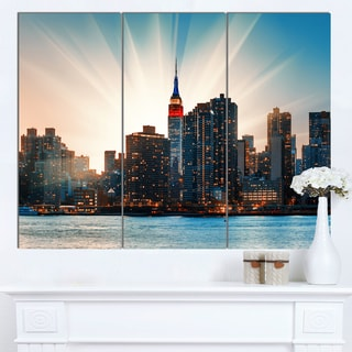 Designart 'Manhattan Skyline at Bright Sunset' Extra Large Cityscape Wall Art on Canvas