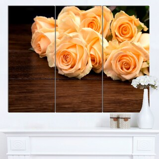 Designart 'Roses on Wooden Surface Photo' Floral Canvas Artwork Print