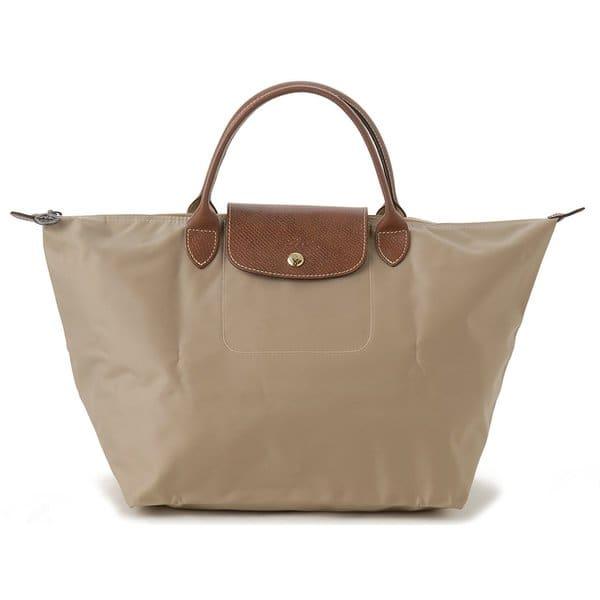 Shop Longchamp Le Pliage Medium Beige Foldable Tote Bag - Free ... 64319c3f2221a