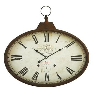 daphne brown metal oval wall clock