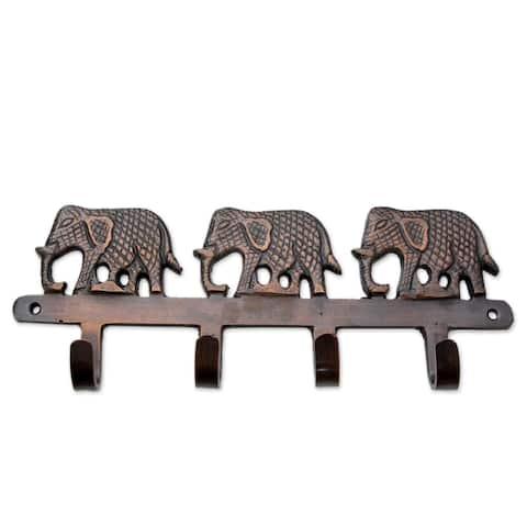 Handmade Brass Key Holder, 'Adventurous Elephants' (India)