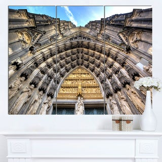 Designart 'Facade of the Dom Church in City' Large Cityscape Art Print on Canvas