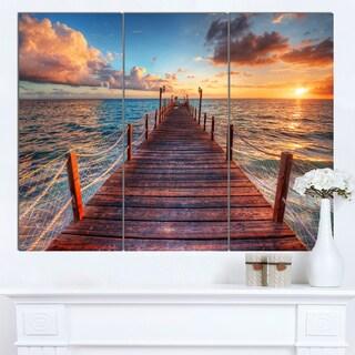 Designart 'Sunset over Wooden Sea Pier' Modern Bridge Canvas Wall Art
