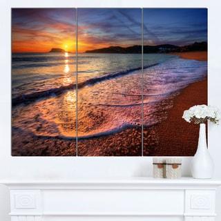 Designart 'Foaming Waves at Beautiful Sunset' Seashore Art Print on Canvas