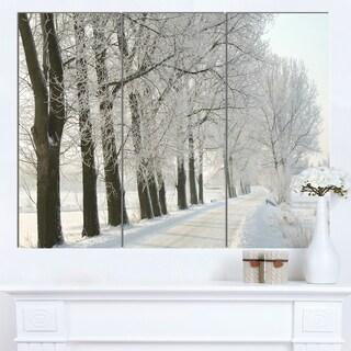 Designart 'Winter Rural Road at Sunrise' Large Forest Artwork Canvas