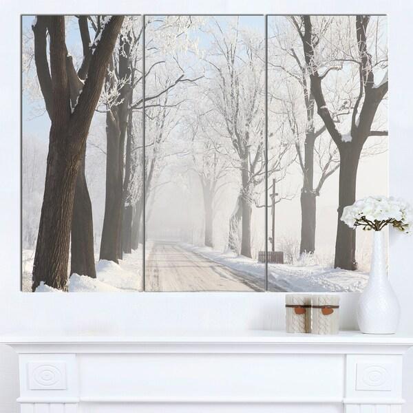 Designart 'Misty Rural Road in Winter Forest' Large Forest Artwork Canvas - ivory