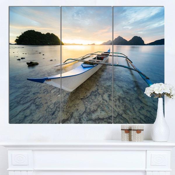 Designart 'Boat Docked at Beautiful Sunset' Modern Seashore Canvas Wall Art Print - multi
