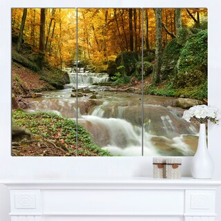 Designart 'Forest Waterfall with Yellow Trees' Landscape Artwork Canvas Print - Green