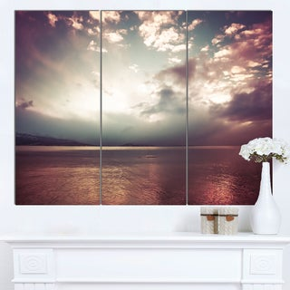 Designart 'Dark Sunset with Dramatic Sky' Large Seashore Canvas Artwork Print