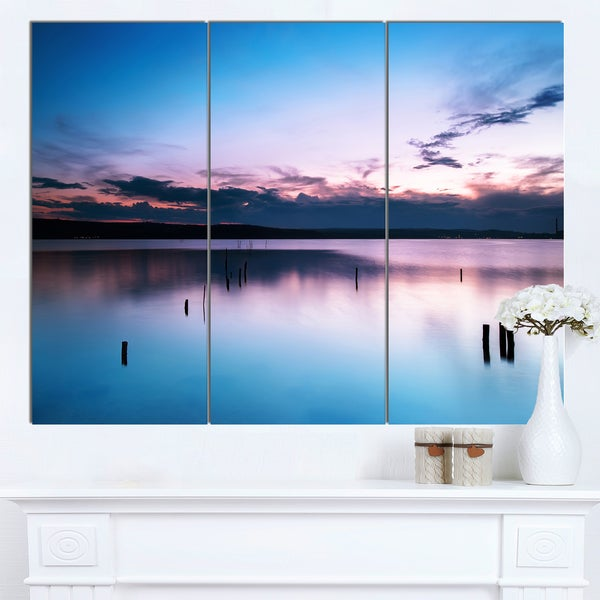 Designart 'Sunset Over Lake Blue Everywhere' Modern Seashore Canvas Wall Art Print