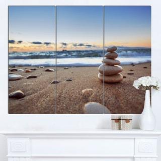 Designart 'Stones Balance on Sandy Beach' Modern Seashore Canvas Wall Art Print