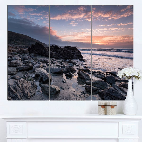 Designart 'Sunrise at Rocky Portholland Beach' Modern Seashore Canvas Wall Art Print