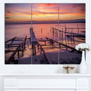 Designart 'Fishing Pier in Sea at Sunset' Modern Seashore Canvas Wall Art Print