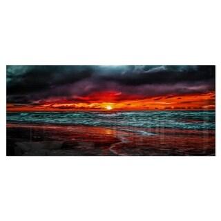 Designart 'Red Sunset over Blue Waters'Ocean Photography on aluminium