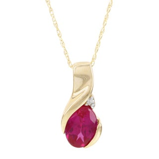 H Star 10k Yellow Gold Oval Created Ruby and Diamond Accent Pendant (I-J, I2-I3)