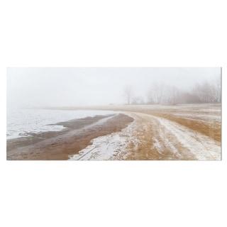 Designart 'Sandy Beach in the Winter Fog' Photography Seashore Metal Wall Art