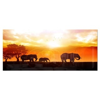 Designart 'Elephants Walking At Sunset' African Metal Wall Art