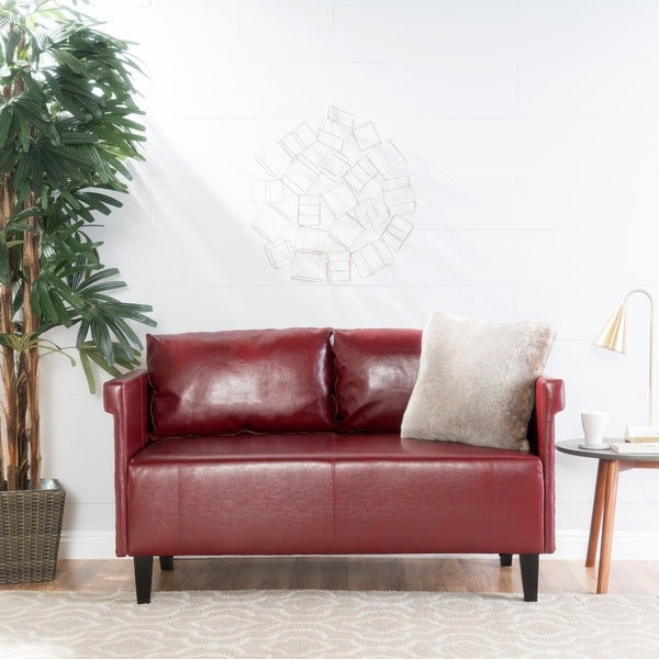 """Bellerose Faux Leather Loveseat Settee Sofa by Christopher Knight Home - 27.50""""H x 54.75""""W x 26""""D. Opens flyout."""