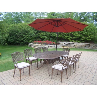 Dakota 10-Pc Dining Set w/ 1 Oval Table, 8 Cushioned Chairs, 10-ft Orange Cantilever Umbrella and Metal Base