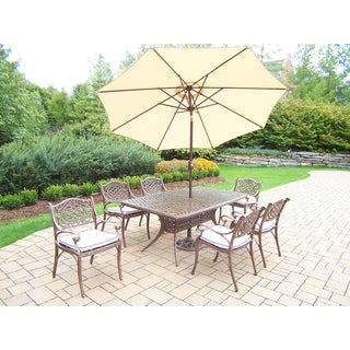 Merit 9 Pc Dining Set with Boat Table, 6 Oatmeal Cushioned Chairs and Beige Umbrella with Stand
