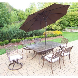 Merit 9 Pc Dining Set with Boat Table, 2 Cushioned Swivel Rockers, 4 Cushioned Chairs and Brown Umbrella with Metal Stand