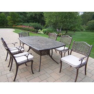Casselton 7 Piece Dining Set with Boat Dining Table and 6 Oatmeal Cushioned Chairs