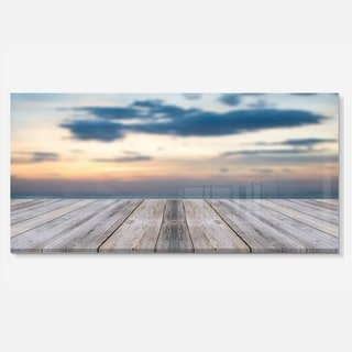Designart 'Wooden Board at Sunset Seashore' Modern Bridge Metal Wall Art