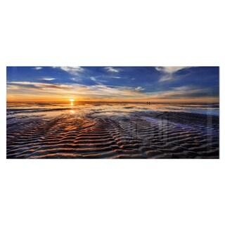 Designart 'Waves On the Sand During Sunset' Seashore Art Metal Wall Art