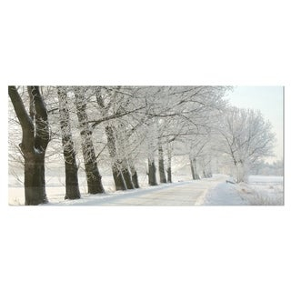 Designart 'Winter Rural Road at Sunrise' Large Forest Metal Wall Art