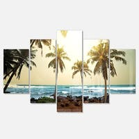 Designart 'Rocky Tropical Beach with Palms' Seashore Metal Wall Art