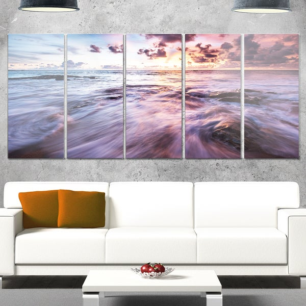 Designart 'Waves Hitting Rocky Beach' Beach Glossy Metal Wall Art