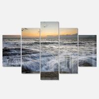 Designart 'Troubled Sunset Sea Waves' Beach Glossy Metal Wall Art