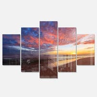 Designart 'Colored Clouds in Beach at Sunset' Large Seashore Glossy Metal Wall Art