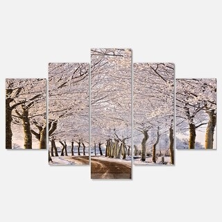 Designart 'Trees And Road in White Winter' Landscape Artwork Glossy Metal Wall Art