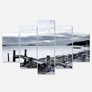 Designart 'Small Sea Bridge from Rocky Beach' Landscape Artwork Glossy Metal Wall Art