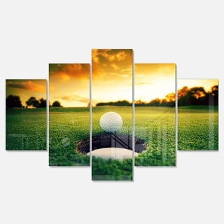Designart 'Golf Ball Near Hole' Landscape Artwork Glossy Metal Wall Art