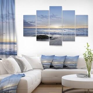 Designart 'Beautiful Rocky Seashore in Blue' Large Seashore Glossy Metal Wall Art