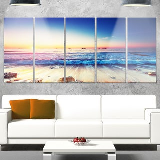 Designart 'Beautiful Sunrise over Blue Sea' Modern Seashore Metal Wall Art