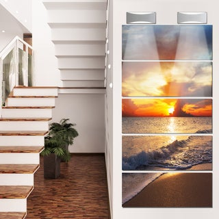 Designart 'Yellow Sunset Through Dark Clouds' Large Seashore Glossy Metal Wall Art