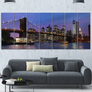 Designart 'Brooklyn Bridge and Manhattan at sunset' Extra Large Cityscape Glossy Metal Wall Art (4 options available)