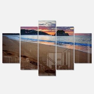 Designart 'Trodden Sand on Ocean Beach' Seashore Glossy Metal Wall Art