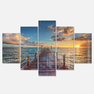 Designart 'Brilliant Sunrise over Sea Pier' Modern Bridge Glossy Metal Wall Art