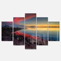 Designart 'Blasts of Color at the Sunset' Seashore Metal Wall Art on