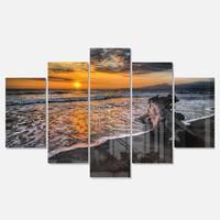 Designart 'Log on Beach During Sunset' Seashore Metal Wall Art on