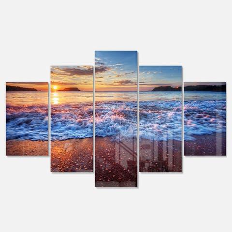 Designart 'Blue Sea Waves during Sunset' Seashore Metal Wall Art on