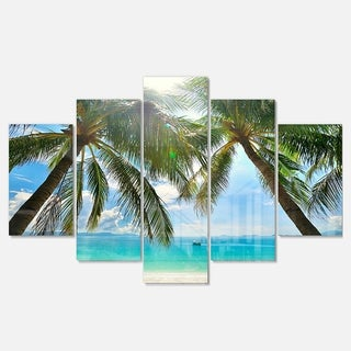 Designart 'Palm Hanging over Sandy White Beach' Seashore Glossy Metal Wall Art